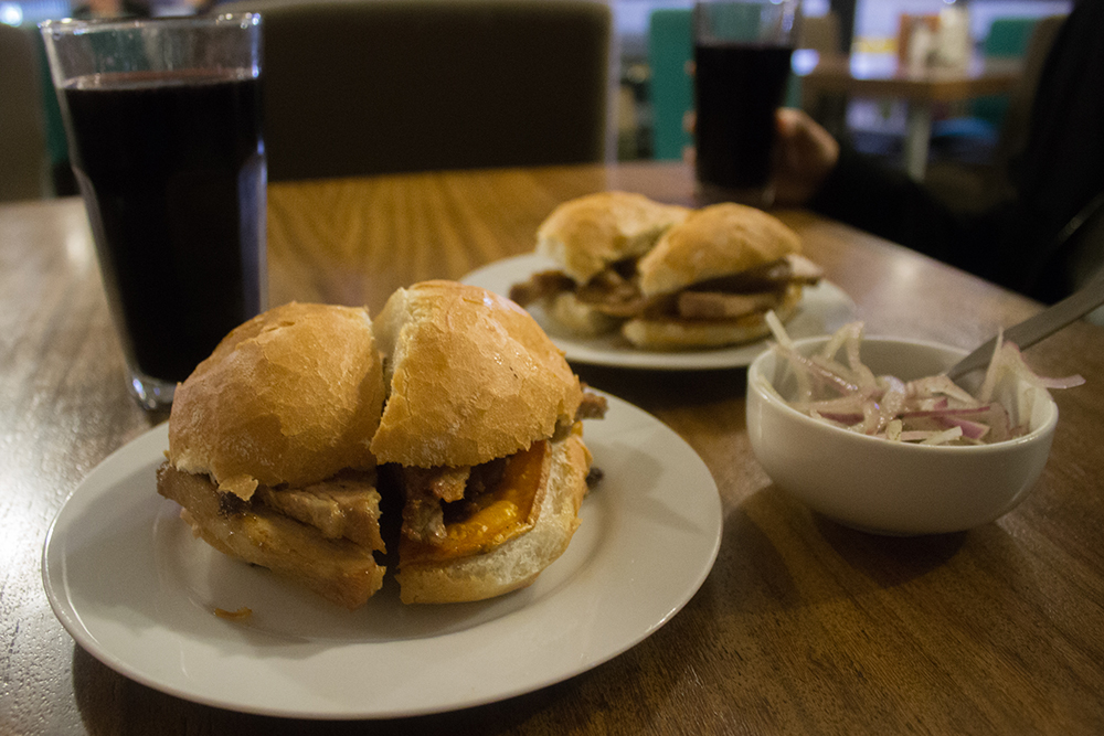Pan con chicharron is a hearty breakfast dish from the Andes.