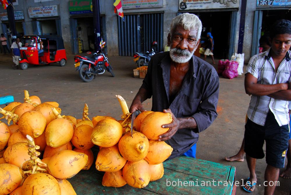 cutting king coconuts at Dambulla wholesale market