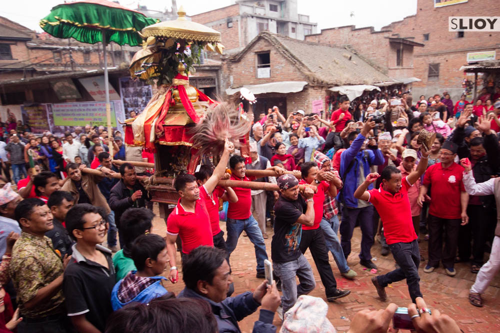 Procession of devotees carrying a shrine at Bisket Jatra festival.
