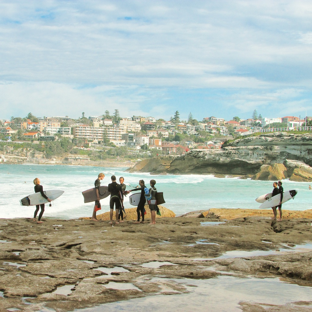 Surfers and bodyboarders congregate along the Bondi to Coogee walk.