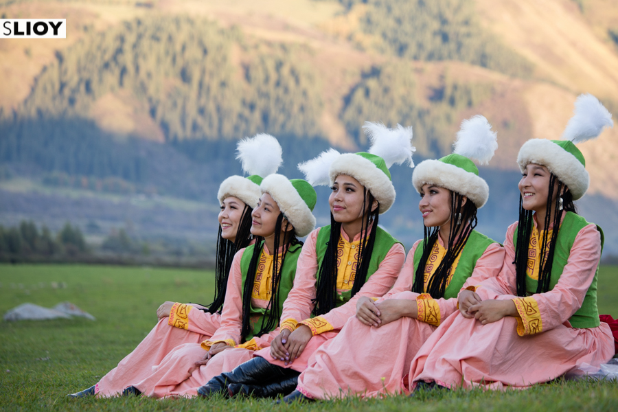 Girls in traditional Kyrgyz clothing at Jailoo Kyrchyn during World Nomad Games 2016.