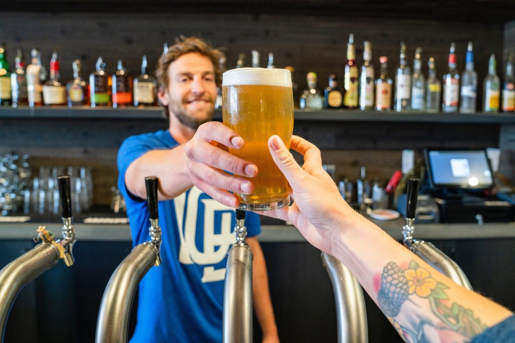 serving beer at a brewery