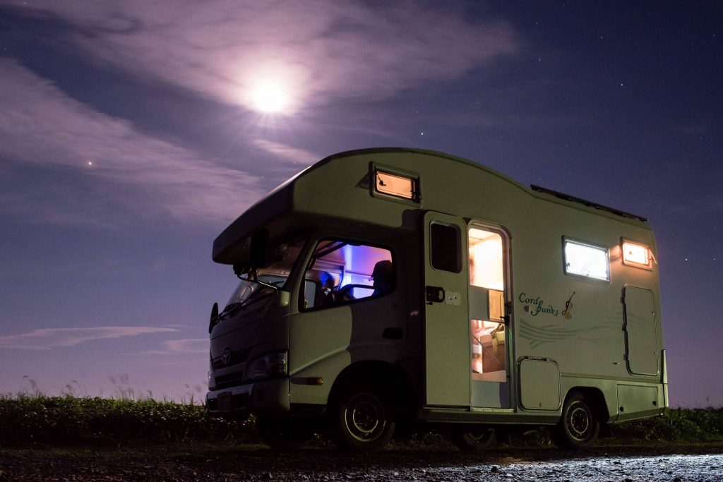 "alt=""Camper van on the road in Hokkaido"""